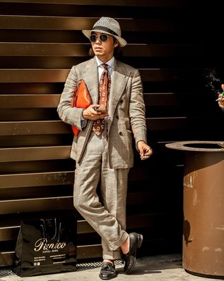 How to wear: orange leather zip pouch, black leather tassel loafers, white dress shirt, beige plaid suit