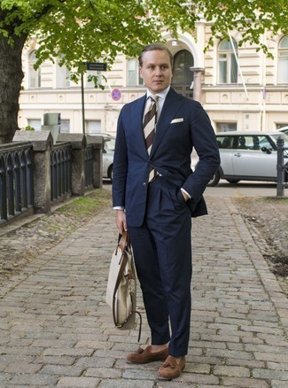 Men's Looks & Outfits: What To Wear In 2020: We love the way this combo of a navy suit and a white dress shirt instantly makes any guy look dapper and sophisticated. Introduce brown suede tassel loafers to the mix to instantly dial up the cool of your getup.