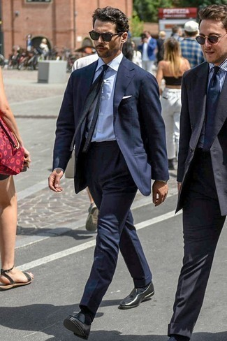How to Wear a Black Knit Tie For Men: For a look that's sophisticated and wow-worthy, pair a navy suit with a black knit tie. Finishing with a pair of black leather tassel loafers is the most effective way to add a mellow vibe to this ensemble.