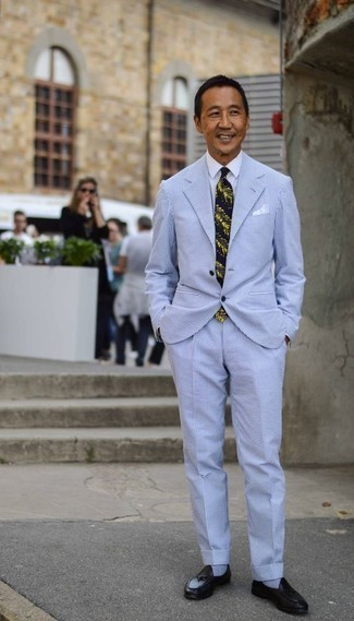 How to Wear a Dress Shirt For Men: You'll be surprised at how easy it is to put together this classy ensemble. Just a dress shirt married with a light blue vertical striped seersucker suit. Black leather tassel loafers will pull your whole getup together.