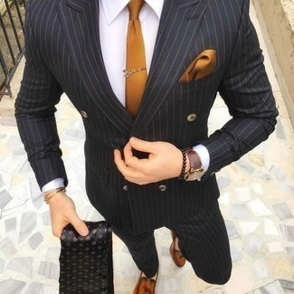 How to Wear a Black Vertical Striped Suit: One of the best ways to style such a timeless menswear item as a black vertical striped suit is to wear it with a white dress shirt. Look at how nice this outfit pairs with a pair of tobacco leather tassel loafers.