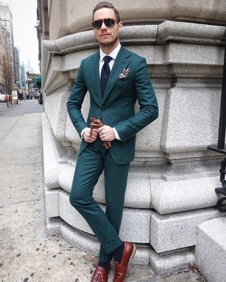 How to Wear Brown Leather Gloves For Men: For an ensemble that's extremely easy but can be worn in many different ways, go for a teal suit and brown leather gloves. For something more on the classy end to finish your outfit, add a pair of burgundy leather tassel loafers to the equation.