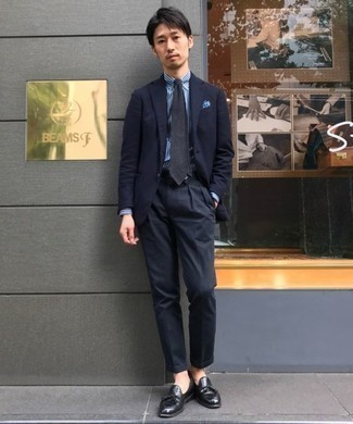 How to Wear Black Leather Tassel Loafers: Channel your inner James Bond and pair a navy suit with a white and blue vertical striped dress shirt. If you're clueless about how to finish off, throw black leather tassel loafers into the mix.