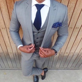 How to wear: navy knit tie, black leather tassel loafers, white dress shirt, grey three piece suit