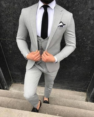 How to Wear a Grey Three Piece Suit: This elegant pairing of a grey three piece suit and a white dress shirt is a frequent choice among the trendsetting gents. A pair of black leather tassel loafers adds more depth to an otherwise dressy look.