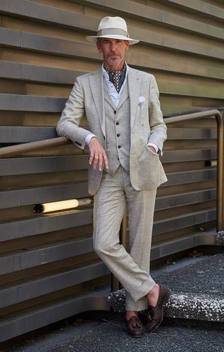 How to Wear a Grey Three Piece Suit: This classy combo of a grey three piece suit and a white dress shirt is a popular choice among the dapper men. If you want to effortlessly tone down your look with shoes, why not complete your ensemble with dark brown woven leather tassel loafers?