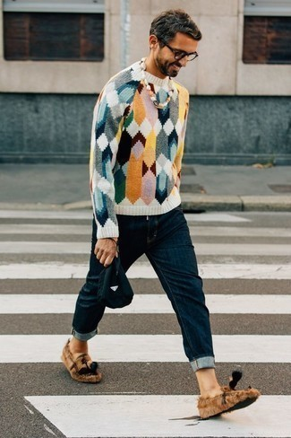 How to Wear a Multi colored Crew-neck Sweater For Men: Reach for a multi colored crew-neck sweater and navy jeans to feel completely confident and look fashionable. Tap into some David Beckham dapperness and introduce a pair of tan canvas tassel loafers to your outfit.