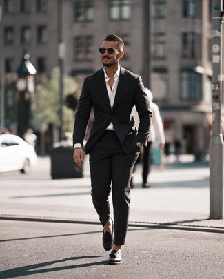 How to wear: black sunglasses, black leather tassel loafers, white long sleeve shirt, black suit