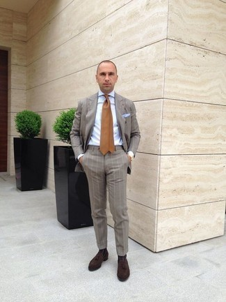 How to Wear a Tan Tie For Men: This sophisticated combo of a grey vertical striped suit and a tan tie will cement your sartorial skills. Don't know how to finish off? Introduce dark brown suede tassel loafers to this outfit to shake things up.