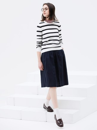 How to wear: multi colored horizontal striped bandana, dark brown leather tassel loafers, navy pleated midi skirt, white and black horizontal striped crew-neck sweater
