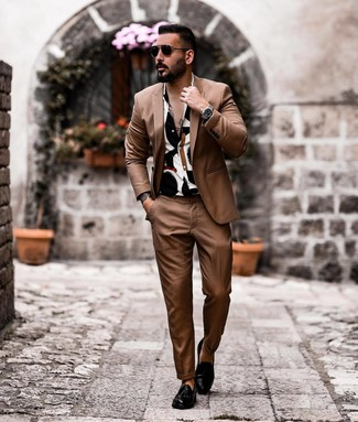 How to wear: black sunglasses, black leather tassel loafers, white and black print short sleeve shirt, brown suit