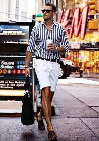 How to wear: black canvas tote bag, dark brown leather tassel loafers, white denim shorts, white and navy vertical striped dress shirt