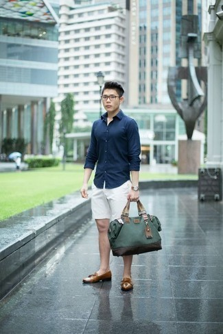 Men's Looks & Outfits: What To Wear In 2020: Extremely stylish, this casual pairing of a navy long sleeve shirt and white shorts provides with a multitude of styling opportunities. Our favorite of a countless number of ways to complete this getup is with tan leather tassel loafers.