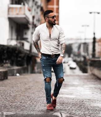 How to wear: black leather belt, burgundy suede tassel loafers, navy ripped skinny jeans, beige long sleeve shirt