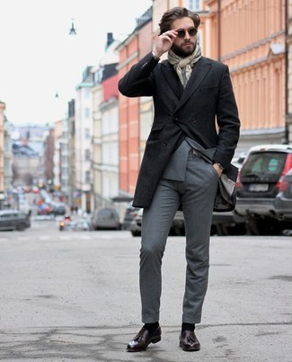 How to Wear a Black Overcoat: Rock a black overcoat with a grey suit if you're going for a neat, fashionable outfit. Get a bit experimental in the shoe department and tone down your outfit with a pair of dark purple leather tassel loafers.