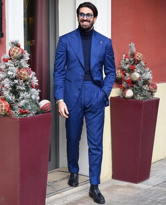 How to wear: blue sunglasses, black leather tassel loafers, navy knit turtleneck, blue vertical striped suit