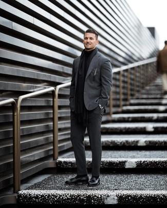 How to wear: black scarf, black leather tassel loafers, black turtleneck, charcoal suit
