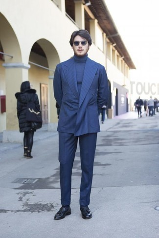 How to Wear a Blue Vertical Striped Suit: This classy combo of a blue vertical striped suit and a blue turtleneck is undoubtedly a statement-maker. Ramp up the formality of this ensemble a bit by slipping into a pair of navy leather tassel loafers.