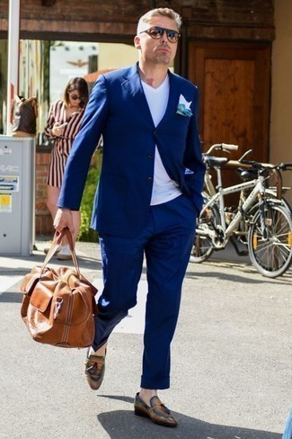 Men's Looks & Outfits: What To Wear Smart Casually: This combination of a navy suit and a white v-neck t-shirt is hard proof that a simple getup doesn't have to be boring. Tobacco leather tassel loafers will dress up any look.