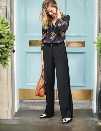 How to wear: tan leather tote bag, black and white suede tassel loafers, black wide leg pants, black floral long sleeve blouse