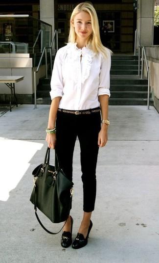 How to wear: dark green leather tote bag, black leather tassel pumps, black skinny jeans, white ruffle dress shirt
