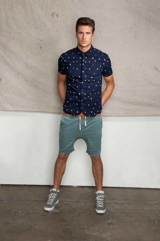 How to wear: grey high top sneakers, teal shorts, orange crew-neck t-shirt, navy print short sleeve shirt