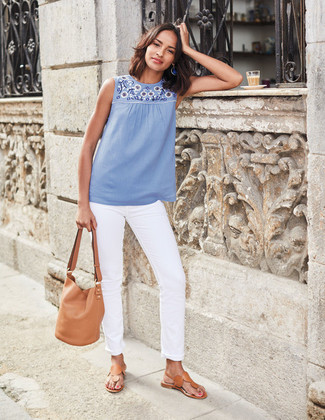 How to wear: tan leather bucket bag, tan leather thong sandals, white jeans, light blue embroidered sleeveless top
