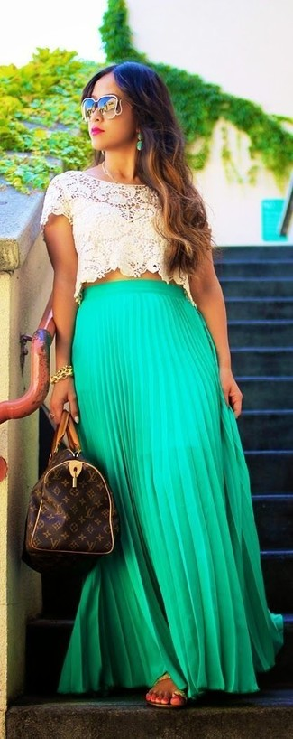 How to wear: dark brown print leather duffle bag, tan leather thong sandals, green pleated maxi skirt, beige crochet cropped top