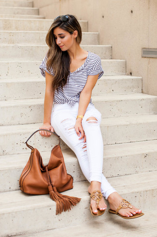 How to wear: tobacco leather tote bag, tan leather thong sandals, white ripped skinny jeans, white and navy horizontal striped crew-neck t-shirt