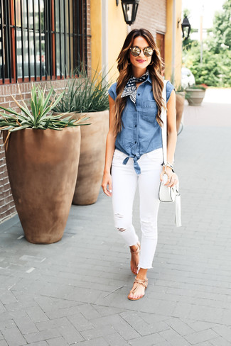 How to wear: white leather crossbody bag, tan leather thong sandals, white ripped skinny jeans, blue chambray sleeveless button down shirt