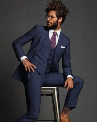 How to wear: navy three piece suit, white dress shirt, tan leather brogues, purple tie