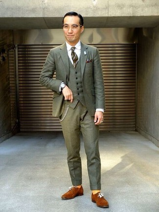 How to wear: olive three piece suit, white dress shirt, tobacco suede derby shoes, olive vertical striped tie