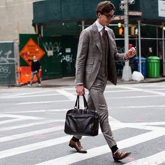 How to wear: brown plaid three piece suit, white dress shirt, brown leather double monks, dark brown leather briefcase