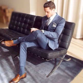 How to wear: blue three piece suit, white dress shirt, brown leather loafers, grey tie
