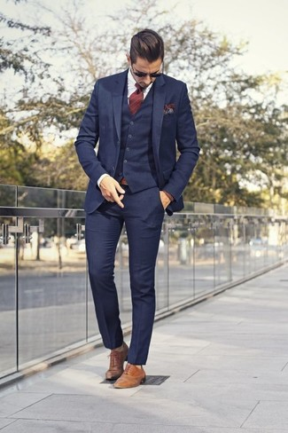 How to wear: navy three piece suit, white dress shirt, tan leather oxford shoes, burgundy vertical striped tie