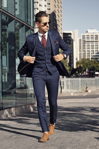 How to wear: navy three piece suit, white dress shirt, tan leather oxford shoes, red vertical striped tie