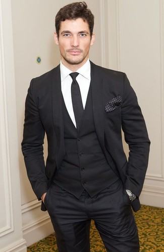 David Gandy wearing Black Three Piece Suit, White Dress Shirt, Black Tie, Black and White Polka Dot Pocket Square