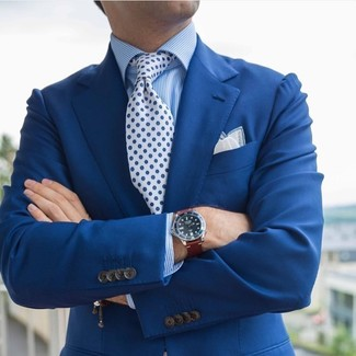 How to wear: white pocket square, white and blue floral tie, blue vertical striped dress shirt, blue blazer