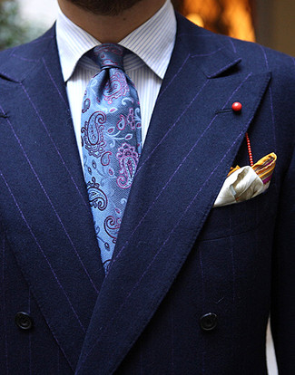 How to Wear a Blue Paisley Tie For Men: For an outfit that's elegant and gasp-worthy, consider wearing a navy vertical striped double breasted blazer and a blue paisley tie.