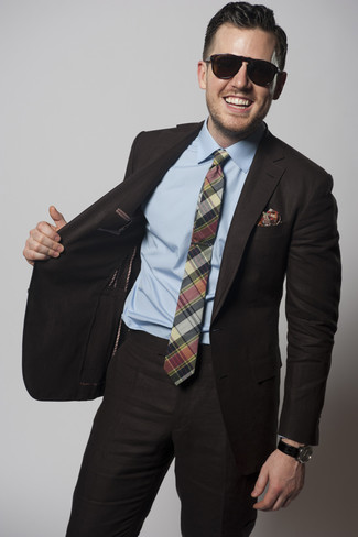 How to wear: red print pocket square, green plaid tie, light blue dress shirt, dark brown suit