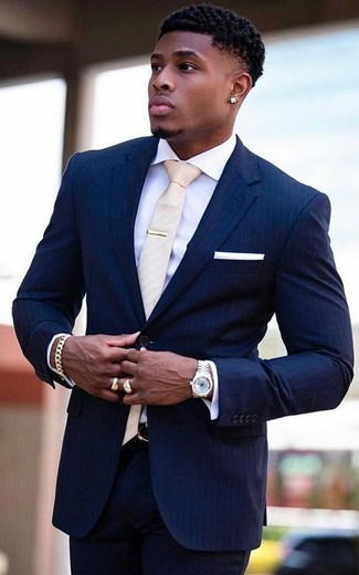 How to wear: white pocket square, beige tie, white dress shirt, navy vertical striped suit