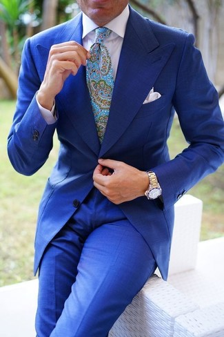 How to wear: white pocket square, aquamarine paisley tie, white dress shirt, blue suit