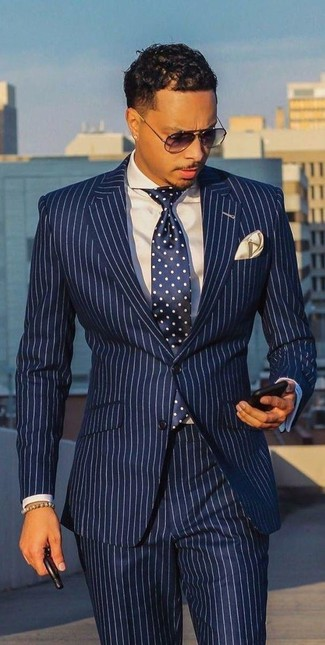 How to wear: beige pocket square, navy and white polka dot tie, white dress shirt, white and navy vertical striped suit