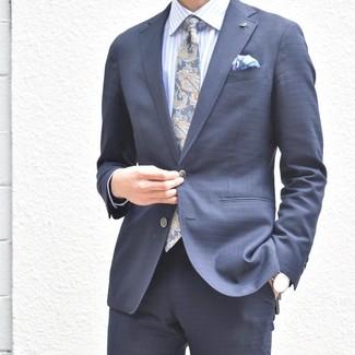 How to wear: light violet print pocket square, navy paisley tie, light blue vertical striped dress shirt, navy suit