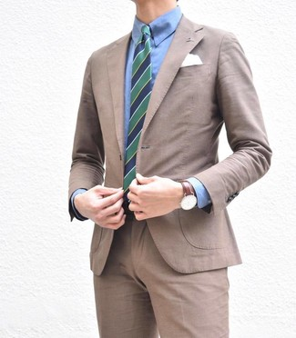 How to wear: white pocket square, navy and green vertical striped tie, blue dress shirt, brown suit