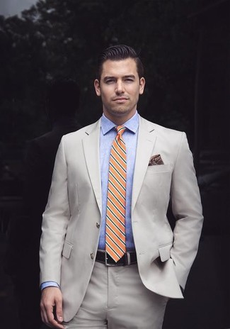 How to wear: burgundy print pocket square, orange horizontal striped tie, light blue chambray dress shirt, beige suit
