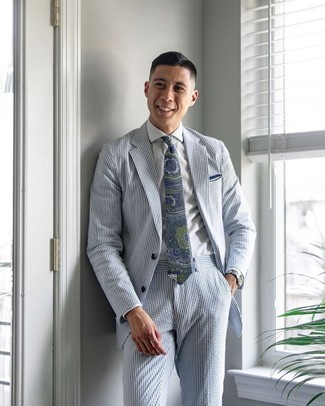 How to wear: white pocket square, navy and green paisley tie, white dress shirt, light blue vertical striped seersucker suit