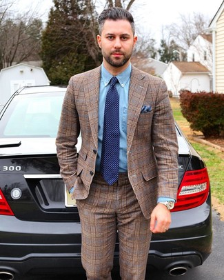 How to wear: blue pocket square, navy polka dot tie, light blue chambray dress shirt, brown plaid suit