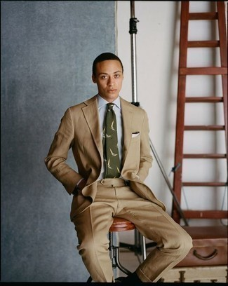 How to Wear an Olive Print Tie For Men: This combination of a tan suit and an olive print tie is a fail-safe option when you need to look like a visionary in the menswear department.