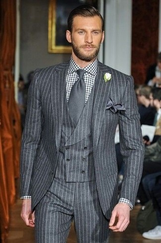 How to wear: charcoal silk pocket square, charcoal tie, black and white gingham dress shirt, grey vertical striped three piece suit
